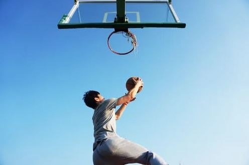 A basketball player about to make a shot